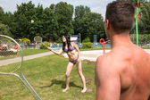 Couple playing badminton at swimming poot or park — Foto de Stock