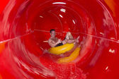 Man having fun sliding down a waterslide — Foto de Stock
