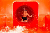 Man in waterslide at public swimming pool — Stock Photo