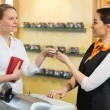 Client at shop paying at cash register — Stock Photo #41025709