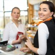 Client at shop paying at cash register — Stock Photo #41025723