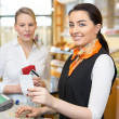 Client at shop paying at cash register — Stock Photo #41025757
