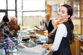 Salesperson at cash register — Stock Photo