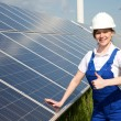 Engineer posing with solar energy panels — Stock Photo #47751233