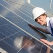 Engineer or installer inspecting solar energy panels — Stock Photo #47751237