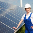 Engineer posing with solar energy panels — Stock Photo #47751239