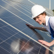 Engineer or installer inspecting solar energy panels — Stock Photo #47751251