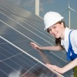 Engineer or installer inspecting solar energy panels — Stock Photo #47751273