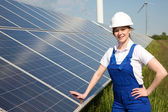 Engineer posing with solar energy panels — Stock Photo