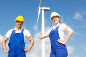 Engineers or installers posing in front of wind energy turbine — Stock Photo