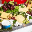 Different sorts of cheese on plate in restaurant — Zdjęcie stockowe