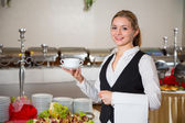 Catering service  employee in restaurant posing with soup dish — Stock Photo