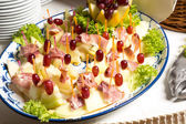 Pineapples with ham on tray at buffet in restaurant — 图库照片