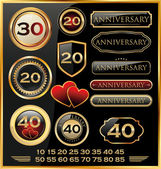 Anniversary golden labels and additional elements — Stock Vector