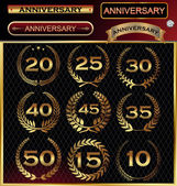 Anniversary golden label with ribbons, golden laurel wreath set — Vector de stock