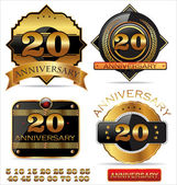 Anniversary golden labels set — Stock Vector