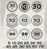 Grunge anniversary rubber stamp set — Vector de stock
