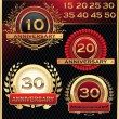 Anniversary golden labels set — стоковый вектор #27101949