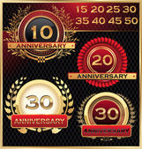 Anniversary golden labels set — Vettoriale Stock