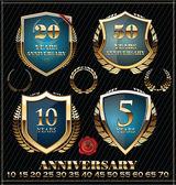 Etichette anniversario oro e blu, golden set di corona di alloro — Vettoriale Stock