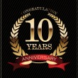 10 years anniversary golden laurel wreath — Vector de stock #30878263