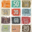 Collection of retro grunge anniversary labels — Stock Vector