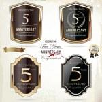 5 years anniversary golden label — Stock Vector #34317395