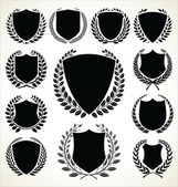 Black shield and laurel wreath collection — Stock Vector