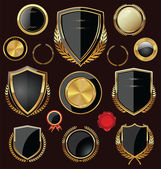 Golden Shields, labels and laurels, collection — Stock Vector