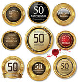 Anniversary golden labels — Vettoriale Stock
