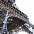 Fragment of Eiffel tower on white — Stock Photo