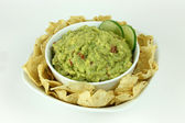 Guacamole with Lime Slices and Tortilla Chips — Stock Photo