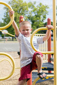 Boy Climbing Up Playscape At Schoolyard Playground — Stock Photo