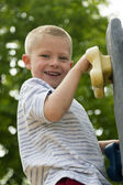 Boy Climbing Rock Wall At Outdoor Playground — Stock Photo