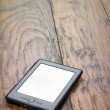 EReader On Wooden Background — Stock Photo