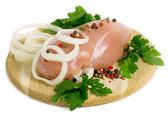 Chicken breast on the wooden board — Stock Photo