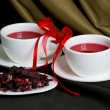Two cups of hibiscus tea and dry petal — Stock Photo