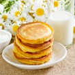 Foto Stock: Homemade pancakes with sour cream and milk