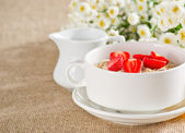 Oatmeal with strawberries in the bowl — Stock Photo