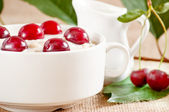 Oatmeal with cherry — Stock Photo
