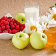 Honey with apples, raspberries and milk — Stock Photo