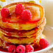 Homemade pancakes with raspberry jam and milk — Stockfoto #28995899