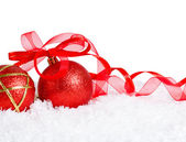 Shiny red Christmas ball with bow — Stock Photo