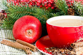 Coffee cup and red apple on the spruce background — Stock Photo