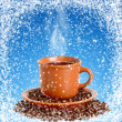 Foto Stock: Cup hot coffee in winter cafe