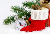 Santa's boot and clock on snow — Stock Photo