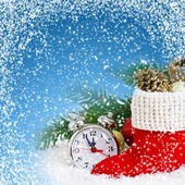 Santa's boot and clock on snow — Stockfoto