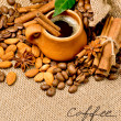 Coffee beans and clay cup — Stock Photo