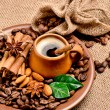 Stock Photo: Coffee beans and clay cup