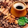 Coffee beans and clay cup — Stock Photo #40107675